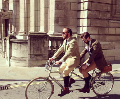 cad and the dandy riding tandem at the tweed run