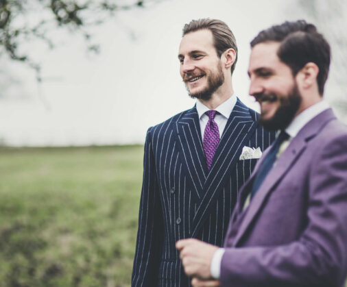 pinstripe-suit-with-purple-tie